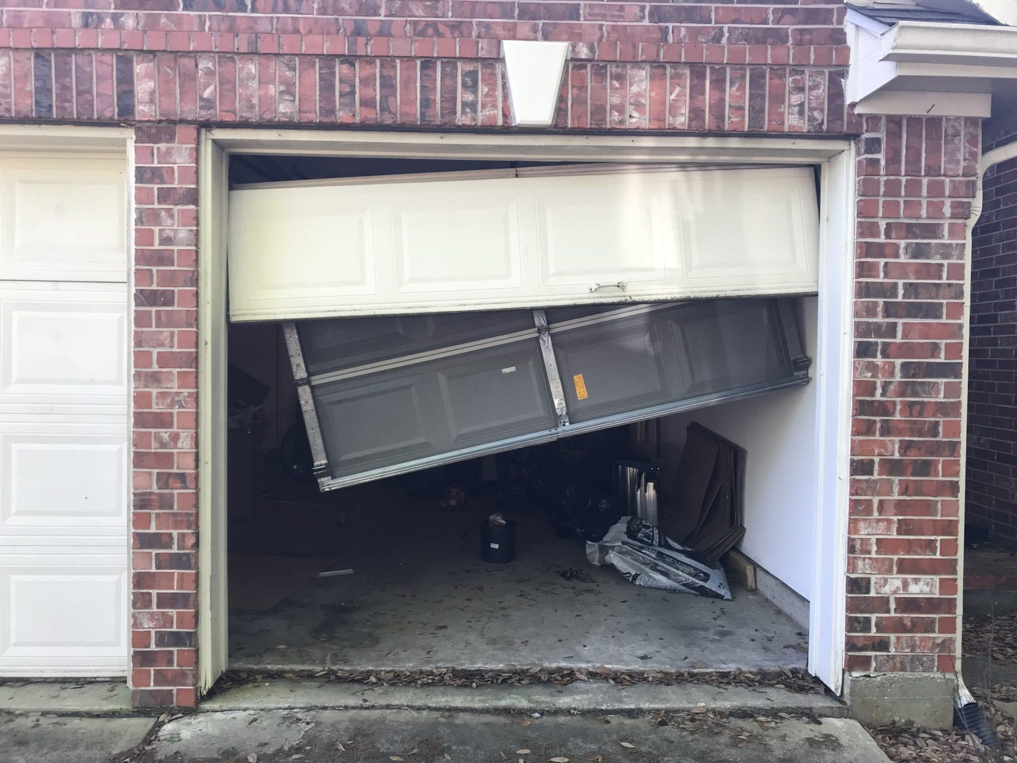 Garage door off the rollers