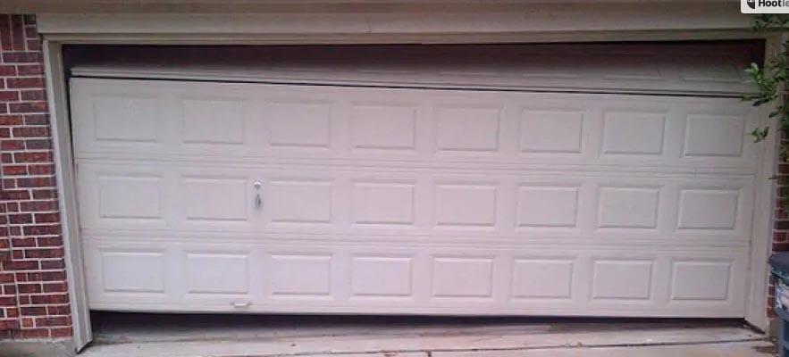 how do you fix a crooked garage door