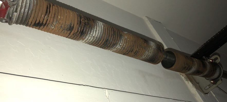 DIY versus professional garage door spring repair.