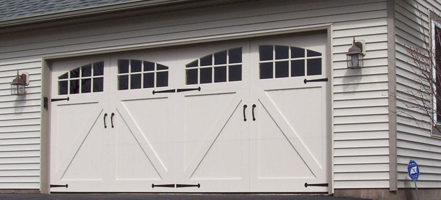 Compare Overhead Doors to Traditional Carriage House Doors